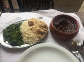Feijoada is a stew of beans with beef and pork of Portuguese origin. It is typically served with rice, sautéed greens, and (again) tapioca flower sautéed with butter and onions.