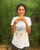 Luiza eating a mango