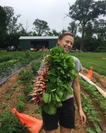 Emma volunteering last summer at Oak Spring Farm