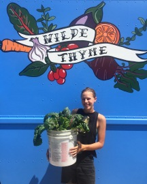 Emma delivering chard to the truck from her garden last summer.